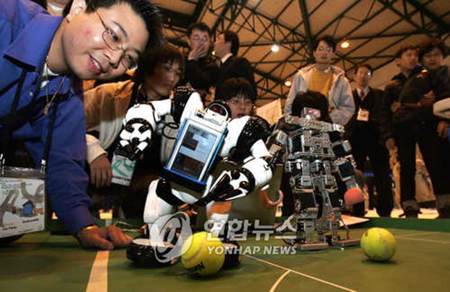 A South Korean university will host the world's very first Artificial Intelligence World Cup later this year, which will see teams consisting of South Korean university students with artificial intelligence algorithm programs competing in multiple events, ranging from AI-based football and sports commentary to writing articles based on the outcome of the games. (Image: Yonhap)