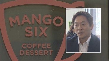 Suicide of 'Coffee King' Sends Shockwaves Through Franchise Industry