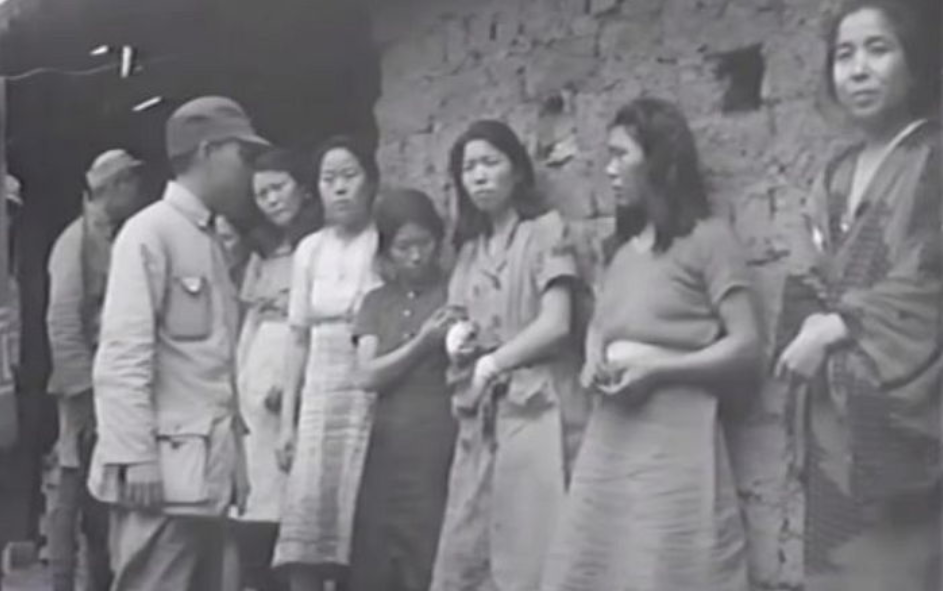 The black and white video footage, a mere 18 seconds long, shows seven comfort women presumably in front of a comfort station. It is believed to have been filmed by a photographer from the U.S. military, which occupied Songshan, China in September, 1944. (Image courtesy of Seoul National University's Human Rights Center)
