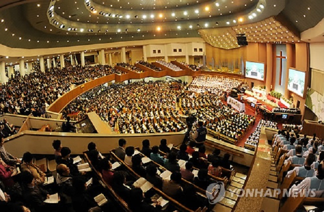"""The results of a survey of 505 Koreans' thoughts regarding the taxation of """"revenue"""" collected by religious denominations was released by research agency Real Meter on August 24. (Image: Yonhap)"""
