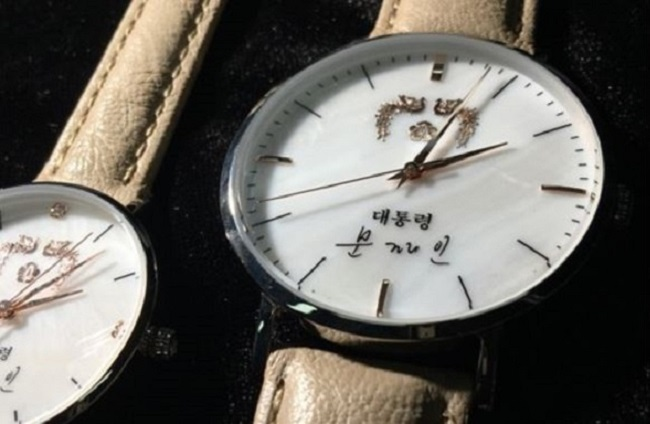 "The ""it"" item that reigns heavy in the minds of the ""Moon Brand"" faithful is the sheepskin strap, President Moon's signature emblazoned gift watch offered to invited guests to the Blue House. (Image: Yonhap)"