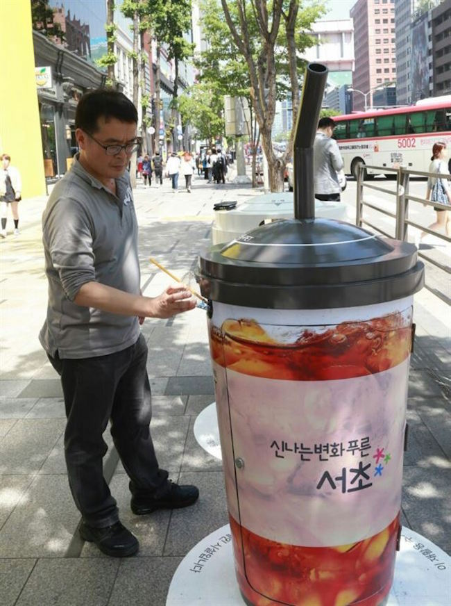 Standing waist high, these garbage bins modeled after typical take-out coffee cups will be constructed of stainless steel. (Image: Seocho District)