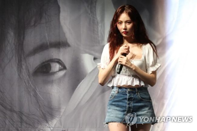 """This album is filled with my hope that fans and followers maintain their interest in me,"" HyunA told reporters at a media showcase held at Blue Square Samsung Card Hall in central Seoul. (Image: Yonhap)"