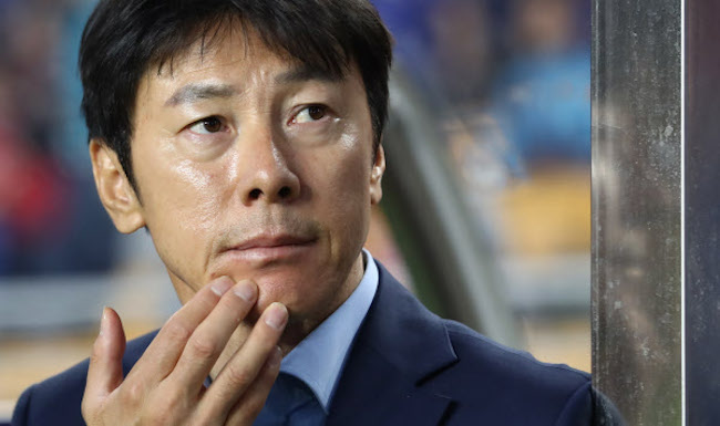"After taking the reins from German predecessor Uli Stielike on July 4, Shin's contract duration was decided as ""until the 2018 Russia World Cup finals"". (Image: Yonhap)"