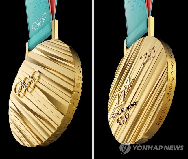 The Olympic medals given to first, second and third place finishers were unveiled today, a sign that the 2018 Winter Games in Pyeongchang are now just around the corner. (Image: Yonhap)