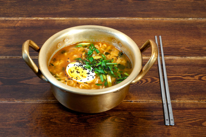 53554697 - korean ramen with egg and green onion on golden pan