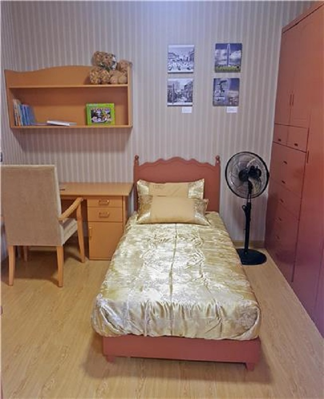 Sparsely decorated with mostly brown furniture, the apartment could be mistaken for an apartment in Seoul (a North Korea sympathizer's home considering the photos on the wall). (Image: Yonhap)