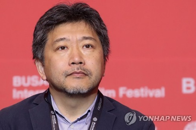"Japanese auteur Hirokazu Kore-eda listens to a question from a reporter during a news conference announcing his plan to executive produce ""Ten Years Japan"" during the 22nd Busan International Film Festival on Oct. 16, 2017. (Image: Yonhap)"
