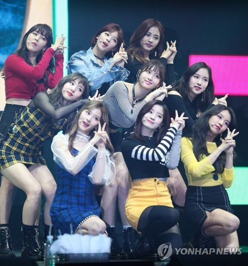 """TWICE has just celebrated their second anniversary but has grown to be one of the most impactful acts in the K-pop scene. It has notched up success after success for its songs such as """"Like Ooh-Ahh,"""" """"Cheer Up,"""" """"TT"""" and """"Knock Knock"""" and """"Signal."""" (Image: Yonhap)"""