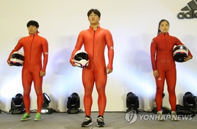 New, bright orange uniforms for the South Korean bobsleigh team have been unveiled which feature patterns inspired by the national flag printed around the neck area. (Image: Yonhap)