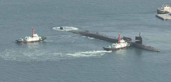 The Ohio-class guided-missile submarine USS Michigan (SSGN-727) arrived at the southern port of Busan as part of a regularly scheduled deployment to the Western Pacific, it said. (Image: Yonhap)