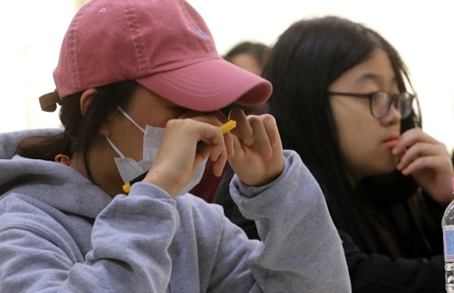 With the unprecedented postponement of the country-wide college entrance exams declared yesterday, the nation's 18-year olds have seen their fair share of unexpected disruptions to their academic lives, occurrences that have left some to wonder whether being born in 1999 was a stroke of bad fortune. (Image: Yonhap)