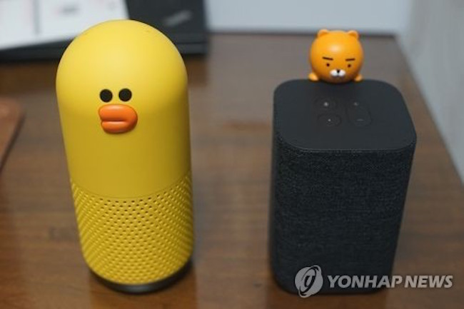 "Besides competing for users, both companies have faced off in the burgeoning AI-integrated speaker market. KakaoTalk's ""Kakao Mini"" and Naver Line's ""Friends"" have enjoyed explosive popularity, selling hundreds to thousands of devices in a matter of minutes after their release. (Image: Yonhap)"