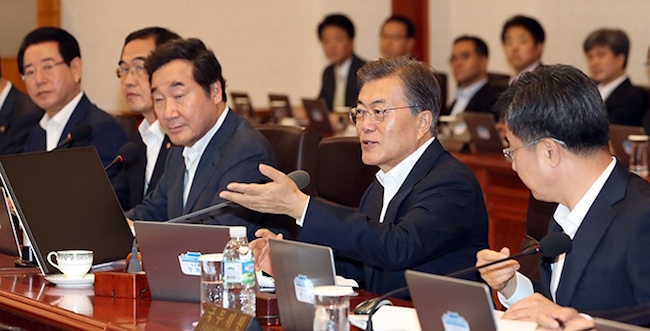 "President Moon Jae-in during a cabinet meeting on November 21 said, ""With the PyeongChang Winter Olympics approaching, I ask the relevant ministries and municipal governments to work together and exert maximum effort in triggering a quick response and preventing the spread of the avian influenza virus."" (Image: Yonhap)"