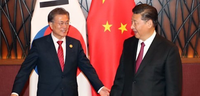 Moon sat down for a face-to-face with China's leader Xi Jinping in Vietnam on November 11, the first time the two had spoken since July due to frustrations from Beijing over the installation of U.S. THAAD missile systems on the peninsula. (Image: Yonhap)