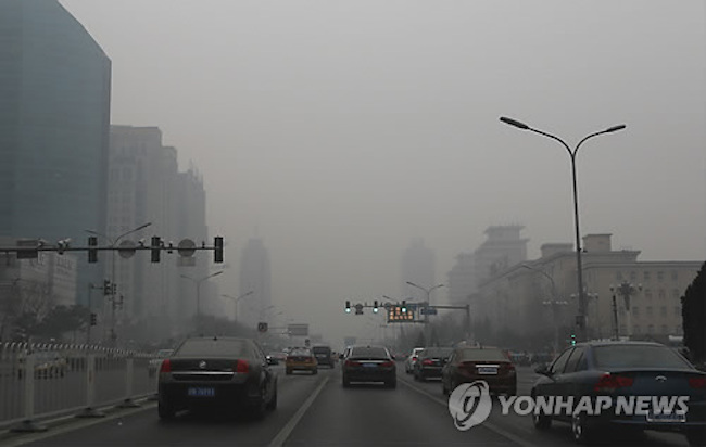 As photos of smog-filled Beijing's skyline indicate, air pollution is critical there, generated by both regional denizens who rely on coal for heating and the manufacturing sector spread throughout the region. (Image: Yonhap)