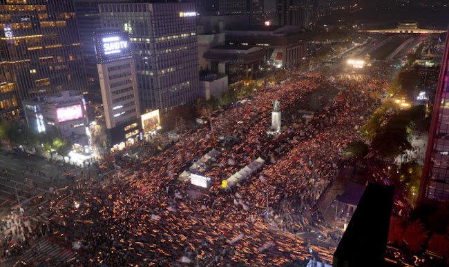 Nearly a quarter said they had participated in the candlelight protests (28.4 percent), and three quarters said they approved of them (75.1 percent). (Image: Yonhap)