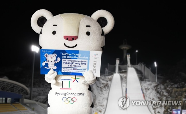 President Moon Jae-in showed off his tickets for the 2018 PyeongChang Winter Olympics online on Sunday, lending help to boost ticket sales. (Image: Yonhap)