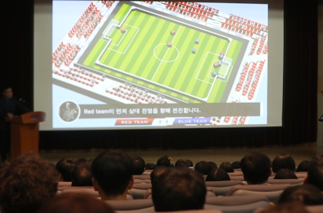 Each football team was made up of five AI, who as the game went on, learned to play with each other.  (Image: Yonhap)
