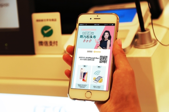 The duty-free unit of Shinsegae, a major retailer here, said Thursday it will provide a membership service for users of WeChat, China's leading messaging app, as it attempts to expand its presence overseas. (Image: Yonhap)