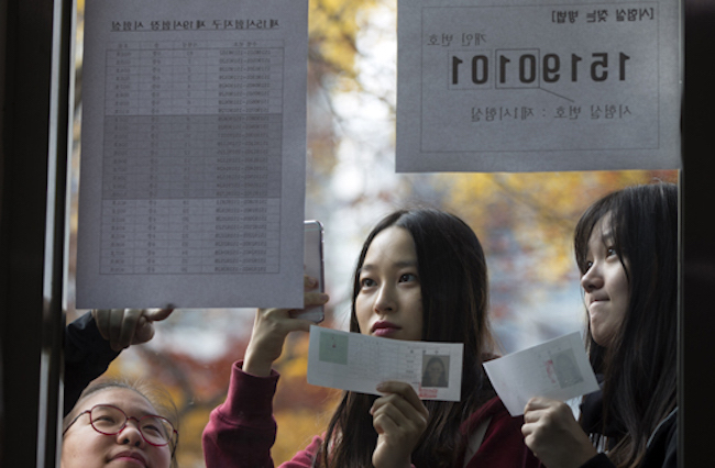 "If every answer chosen was ""5"", that would guarantee a raw score of 11, placing the student in the fifth tier with a standard score of 46 and a percentile rank of 39. (Image: Yonhap)"