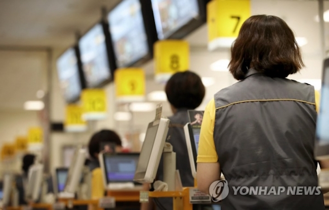 In addition, 49 percent of the participants who revealed that they had become sick at work said they had reported to their job even when feeling under the weather. The average accumulated period that this group had done so was 5.2 days. (Image: Yonhap)