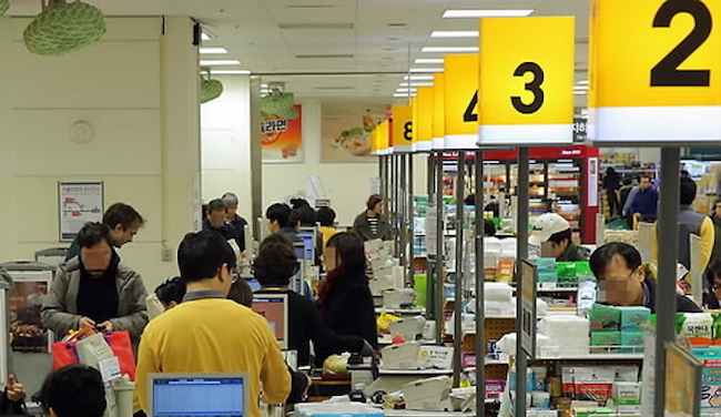 At least half of the workers holding down service jobs in the retail sector have reported to work despite feeling unwell, a survey has found. (Image: Yonhap)