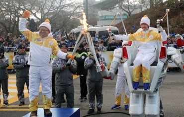 History Made as Robots Carry Olympic Torch