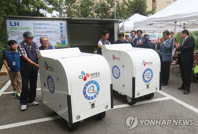 "In the areas where the so-called ""silver-haired delivery service"" is being operated, elderly staff living in the district pick up their daily quotas from package delivery cargo trucks and drop them off door-to-door. (Image: Yonhap)"