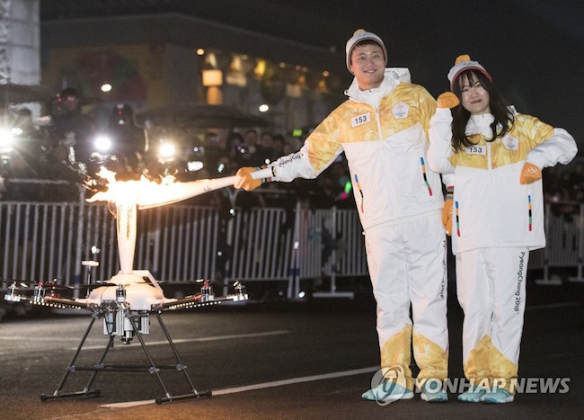 "On Saturday night, Octacopter, a drone weighing 11 kg and measuring 110x110x91 cm, began its brief ""run"" from the 40th Anniversary Monument to King Gojong's Enthronement and flew the 150 m distance to KT's Gwanghwamun Square building in roughly three minutes. (Image: Yonhap)"