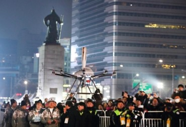 In Two Firsts, Drone Carries Olympic Torch at Night in Seoul City Square