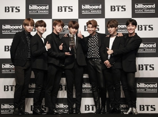 "K-pop boy group BTS sold more than 500,000 copies of its eighth single ""MIC Drop/DNA/Crystal Snow"" in Japan in December, becoming the only foreign artist last year to pull off such sales, the group's agency Big Hit said Tuesday. (Image: Yonhap)"