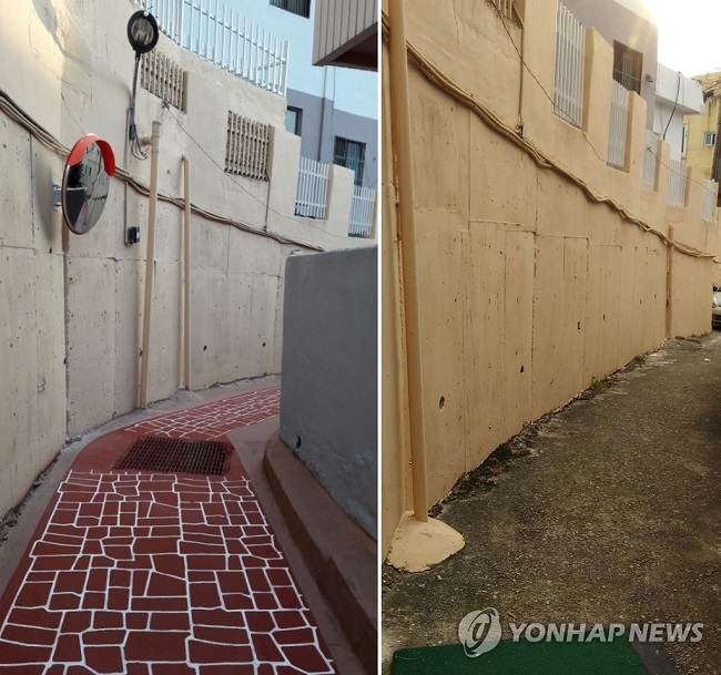 The police invested 10 million won in the alley in Bugok 2-dong, increasing the number of street lamps, repainting walls and paving the path in a bright red lined with white. (Image: Busan Metropolitan Police Agency)