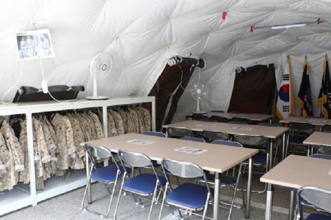 One building that was formerly used as the U.S. military officers' residential quarters was renovated and from then on housed tourist-friendly events such as making military dog tags, trying out uniforms, and experiencing life as a man or woman in the armed forces. (Image: Yonhap)