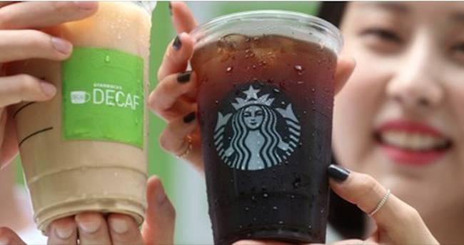 The South Korean love affair with Starbucks burned hot last year, as the Seattle-based coffee behemoth revealed it had sold 83.6 million americanos last year, the coffee chain's number one selling drink for the 11th year running. (Image: Yonhap)