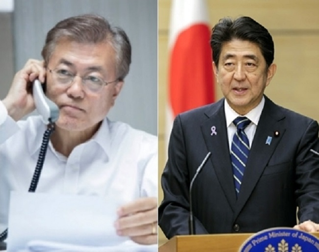 South Korean President Moon Jae-in and Japanese Prime Minister Shinzo Abe are set to hold bilateral talks Friday, amid a renewed dispute over Japan's wartime sexual slavery of Korean women. (Image: Yonhap)