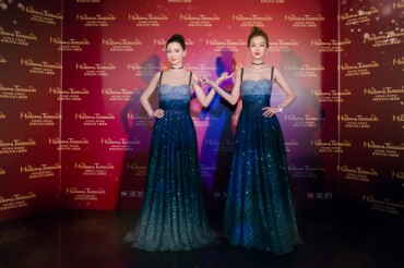 Angelababy Walks the Red Carpet to Madame Tussauds Hong Kong in Blue Gown