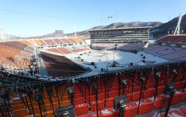 With sub-zero temperatures continuing to grip most of the country amid a severe cold snap, the roofless design of the main stadium is keeping the organizing body on its toes with only three more days to go before the Winter Olympics kicks off. (Image: Yonhap)