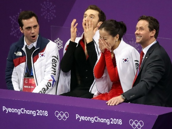 The two American-born South Korean athletes, clothed in hanbok-inspired costumes in an ode to the traditional Korean garment, couldn't hide their emotions after their last performance at this year's Winter Olympics.(Image: Yonhap)