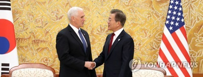 South Korean President Moon Jae-in (R) and U.S. Vice President Mike Pence shake hands before holding talks at Moon's presidential office Cheong Wa Dae in Seoul on Feb. 8, 2018. (Image: Yonhap)