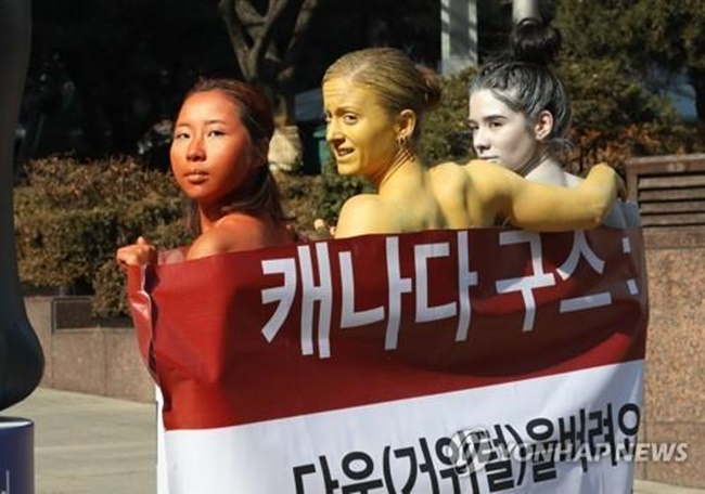 PETA Activists in Body Paint Stage Protest Against Canada Goose Jackets