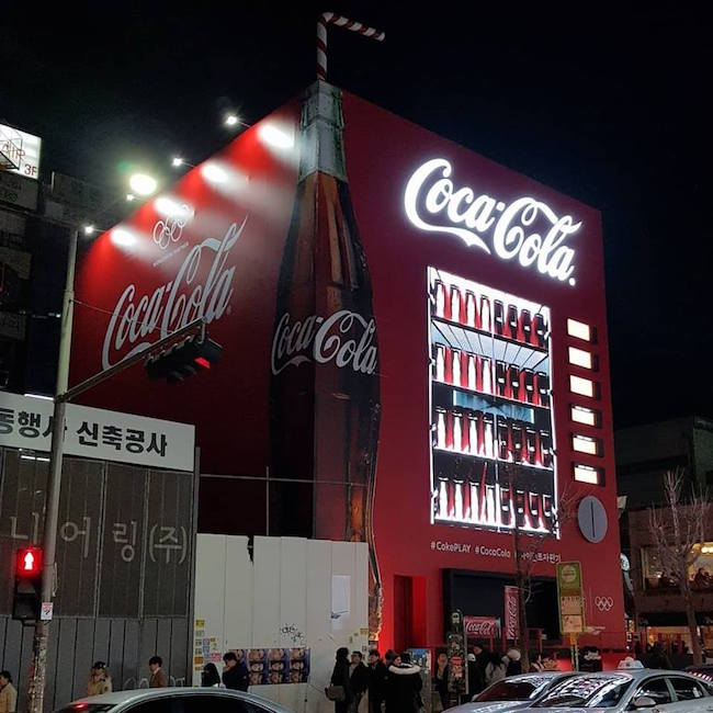 Those staying in Seoul can drop by the popular neighborhood of Hongdae to gain entry into a giant Coca-Cola building that offers various amusements on every floor. (Image: Korea Tourism Organization Facebook)