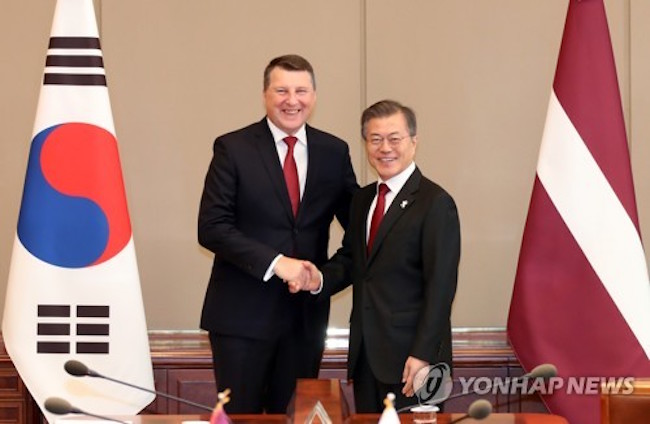 President Moon Jae-in held summit talks with Latvian President Raimonds Vejonis on Tuesday and discussed ways to expand trade and investment between the two countries and increase cooperation on security issues like North Korea, officials said. (Image: Yonhap)