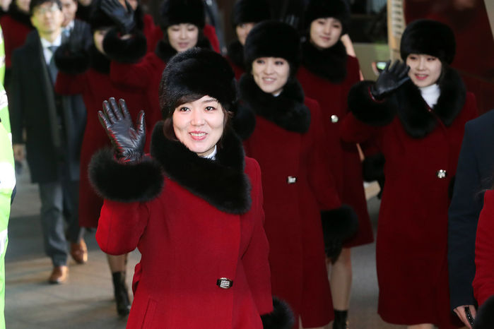 Head held high, Kim's sister returns to North Korea