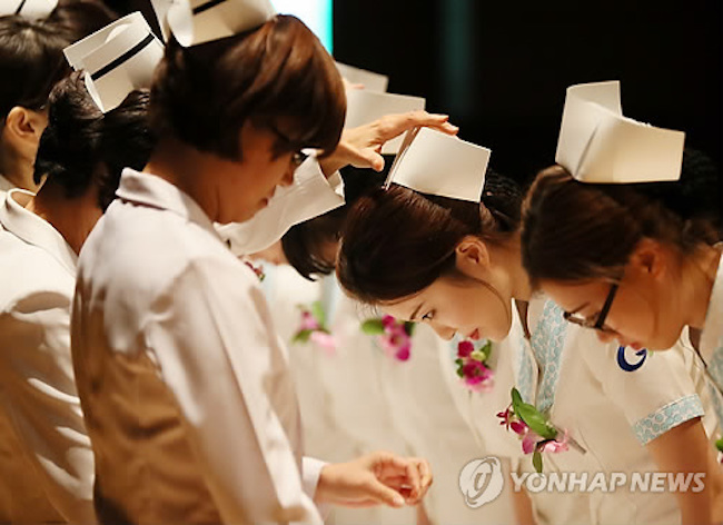 "Meaning ""to burn"" (extended meaning is ""to burn until [he or her] becomes proficient), taeum is a word denoting bullying of a junior nurse by a senior under the guise of mentorship. (Image: Yonhap)"