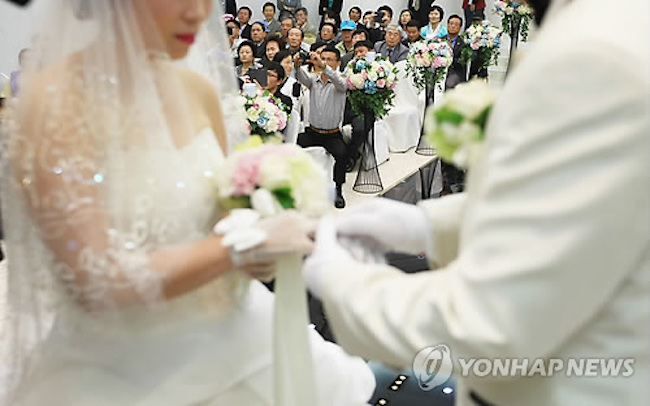 In more good news for international marriages, divorces fell by 7 percent to 7,100. (Image: Yonhap)