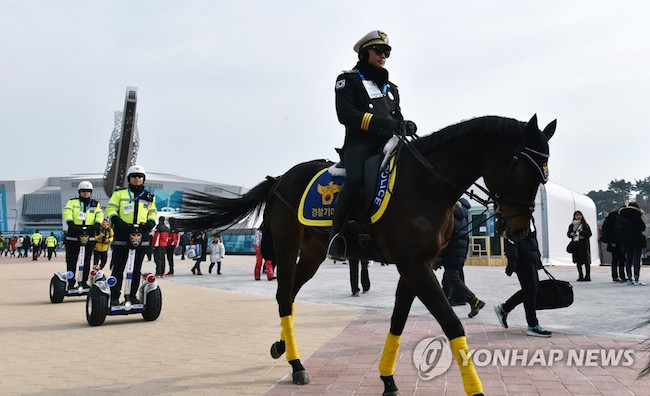 Back on the Olympics grounds, meanwhile, officers on horseback, an uncommon sight for South Koreans hailing from Seoul, and on two-wheel standing scooters carried out patrols to the delight of many. (Image: Yonhap)