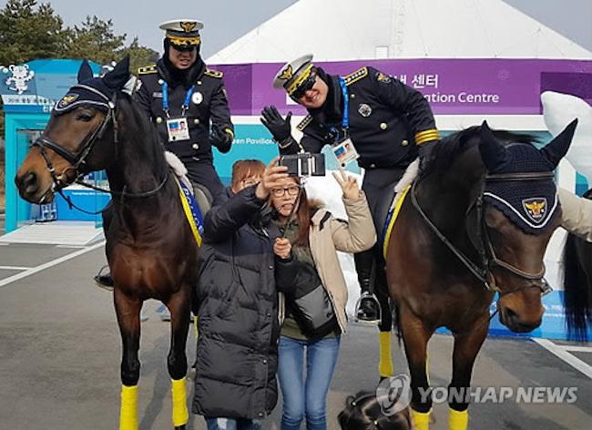 Police on horseback (Image: Yonhap)