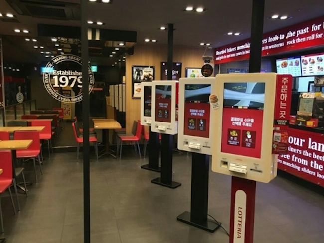 Across the fast food industry, where self-service is a given, Lotteria, Burger King and McDonald's have placed ordering kiosks in over 30 percent of their respective franchises, with the eventual goal of putting one in every store. (Image: Lotteria)