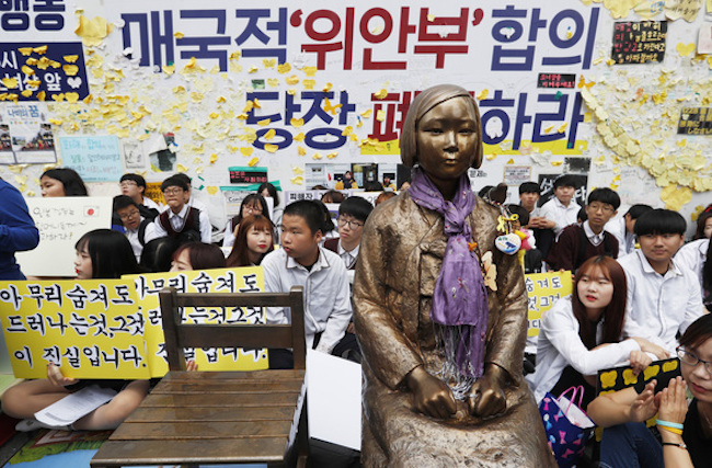 "After a task force had concluded its examination of the deal, Moon issued a statement saying, ""This agreement is insufficient to resolve the comfort women problem."" (Image: Yonhap)"